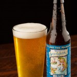 A bottle and pint glass of Sweetwater Blue