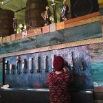 The wall of beer taps at Hi-wire brewery