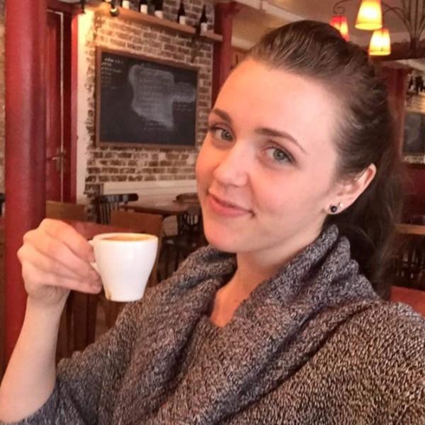 Kristen Bailey sipping an espresso.