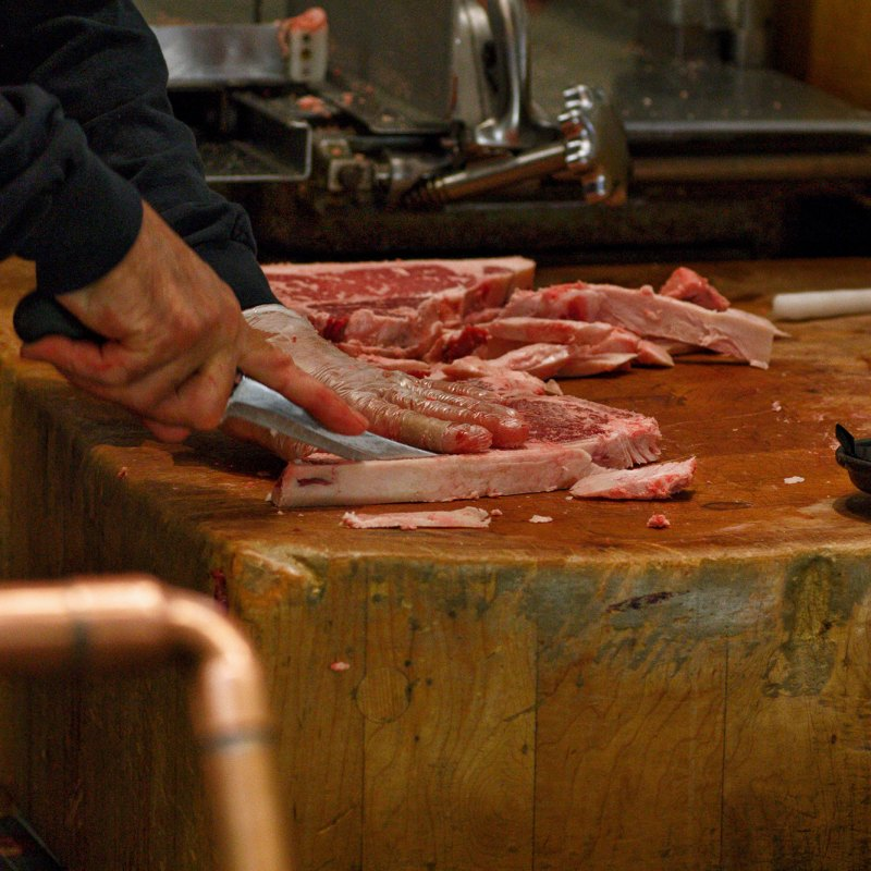 Deboning a cut of meat. - PHOTO // Kevin Rodriguez