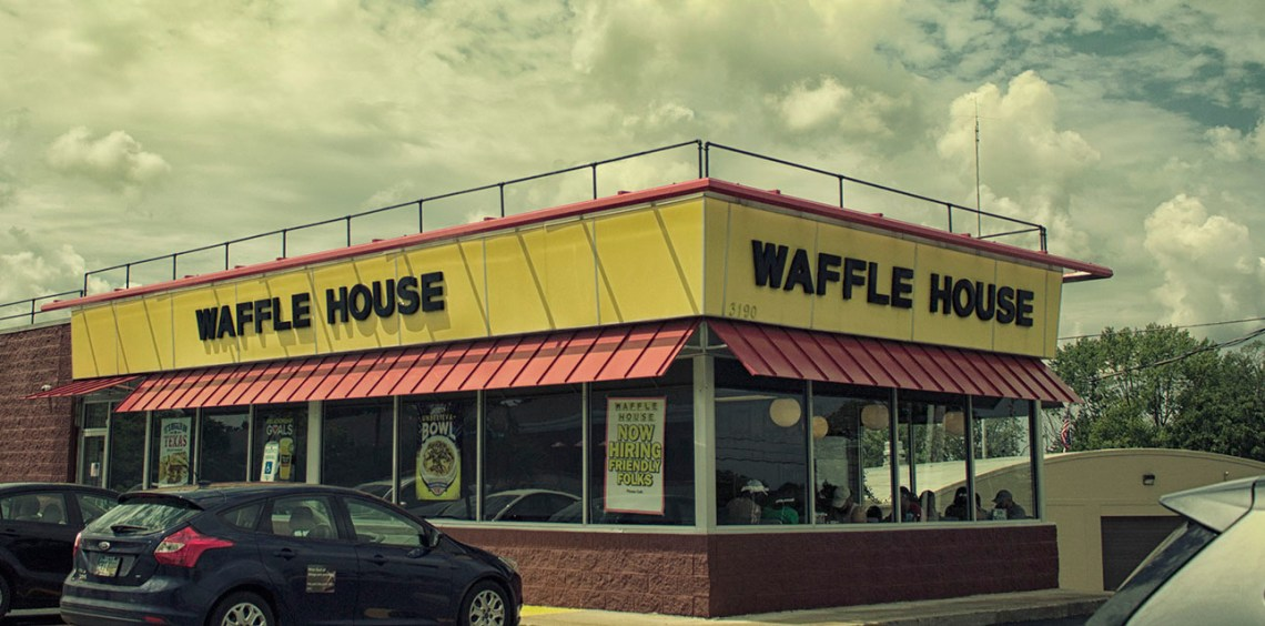 A greasy spoon breakfast restaurant this is a view of Waffle House exterior.