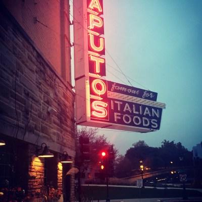 An exterior shot of Saputo's Italian Restaurant at night.