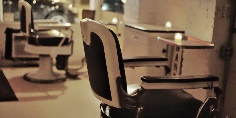 Candlelit chairs inside the Blind Barber