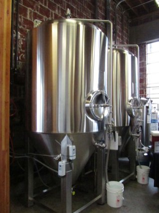 Fermenters at The Commons Brewing.