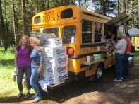 Audrey and Jeanette get their picture taken by the Spud Bus. It turned out Mike knew the owner.