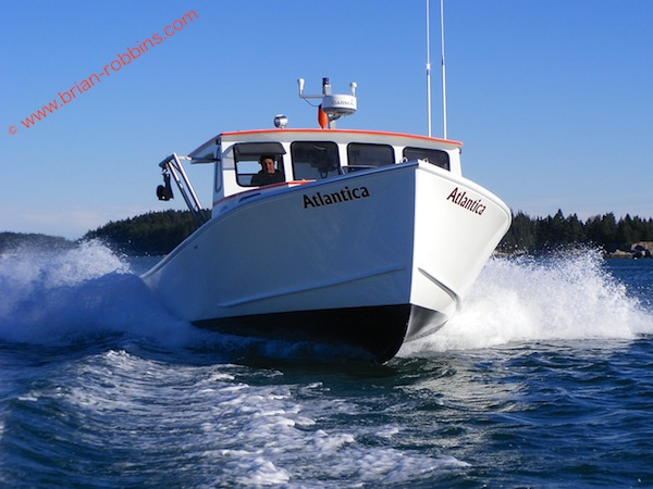 Alec Peasely and his father Buster finished the 34' Calvin Beal Atlantica in just six weeks after receiving the hull and top from SW Boatworks in Lamoine, ME. (2012)