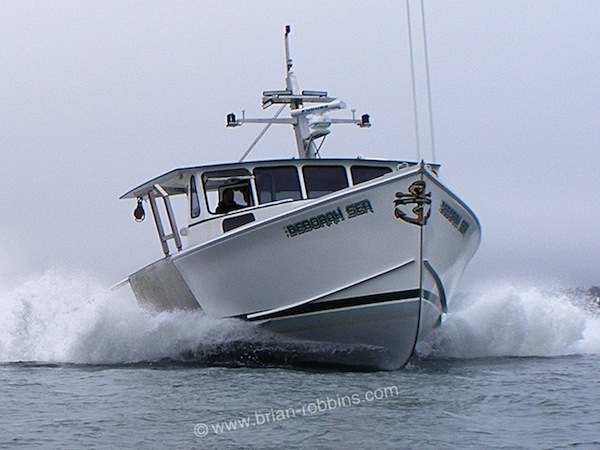 "Harrington, ME lobstermen Jason Strout and Chad Fenton pooled their talents and finished a pair of Osmond 47s for themselves. Fenton's Deborah Sea and Strout's Halestorm were built from Osmond Beal-designed 47'4""x19'2"" hulls and molded tops from H&H Marine Inc. in Steuben. (2015)"