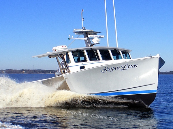 "Susan Lynn is a Calvin Beal 44 owned by father/son lobstermen Shawn and Chris Costa of Provincetown, MA.  SW Boatworks in Lamoine, ME built the 44'x17'6"" hull and molded top; Light's Fiberglass of Steuben did the finishing."