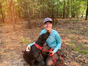 Brianna Lentz with her dog in the Oklahoma Woods