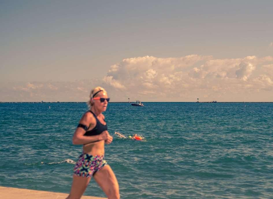 Oak Street Beach - Woman Running - Boats - Lakefront - Chicago