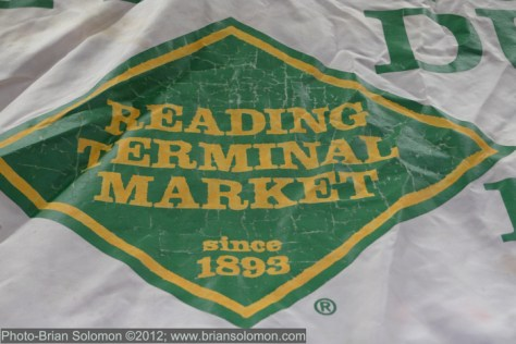 Reading Terminal Market's logo reflects that of the old Reading Company, which like many coal hauling railroads symbolically used the diamond (inferring black diamonds)