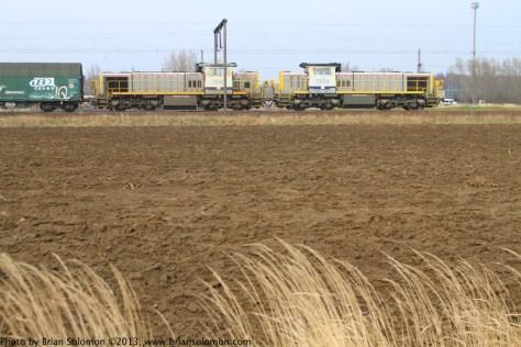 SNCB Vossloh diesels work a mixed freight toward Antwerp port.