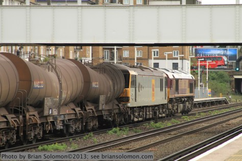 An EWS Class 66 diesel leads a Class 92 electric on a unit freight at Kensington-Olympia on April 19, 2013.