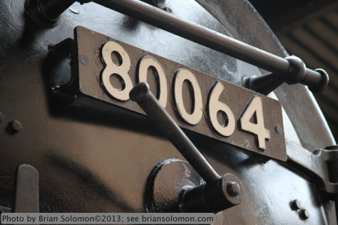 The number plate on a smoke box door catches the hint of a blue sky beyond. Canon EOS7D with 28-135mm lens.