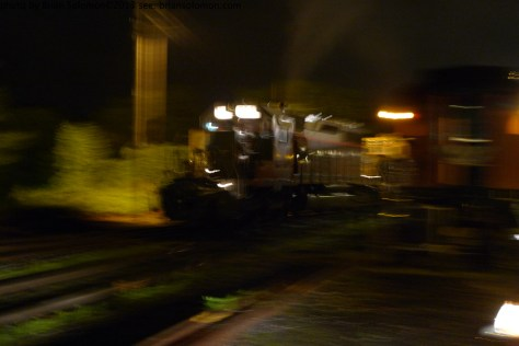 New England Central freight arrives at Palmer yard. Lumix LX3 ISO 200 set at f2.6 1.3 seconds, panned hand held in the rain.
