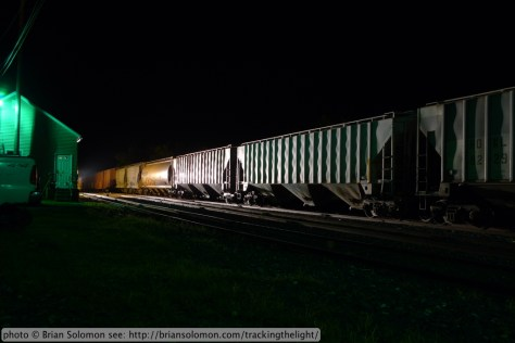 Freight cars at night.