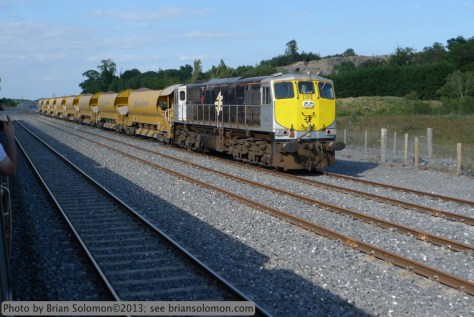 Irish Rail 086 rests with a ballast train at Lisduff as viewed on the return trip of the IRRS special.