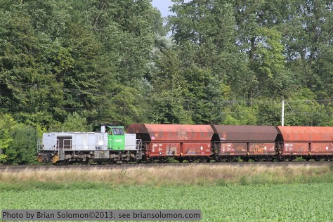 A Vossloh diesel leads a coal train that originated off the RWE network and was delivered via the Deutsche Bahn network. The hoppers are of a smaller lighter variety than those used in captive service on RWE's lines.