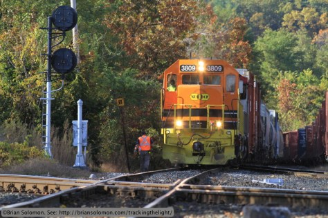 New England Central 3809 has gone across the diamond to collect southbound train 611 and is now returning with the train and looking to re-cross CSX . Canon EOS 7D photo.
