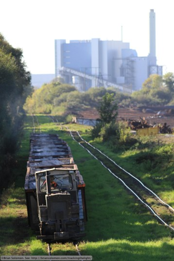 Empty train heads out for reloading against a backdrop of the Lough Rea Power Station at Lanesborough. Canon EOS 7D with f2.8 200mm lens. Photo unmodified except for scanning.