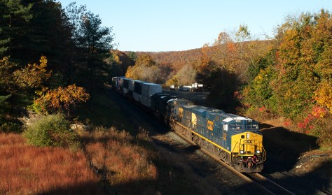 CSX eastward intermodal freight (probably Q012) passes West Warren, Massachusetts on Sunday morning October 20, 2013. Canon EOS 7D with 40mm Pancake lens. A scanner, detailed knowledge of CSX operations, and patience all helped in executing this image.