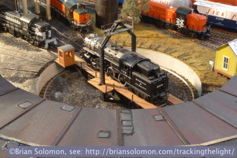 I often use the backlit 'glint' effect for my prototype photos, so I thought I'd try this on the O-scale railroad as well. As with the Erie Mallet, Dan's Boston & Albany tank engine doesn't exactly fit with the period, but I like it anyway! For this view I surrounded the engine with New Haven Alco road-switchers since these locomotives may have coexisted in Framingham or South Boston.