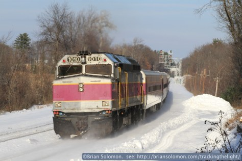 A Boston-bound MBTA train shoves eastward with the locomotive at the back. This is one of the old 'screamers' featured on Tracking the Light on December 21, 2013.