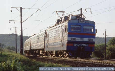 An eastward Ukrainian Railways passenger train catches the evening glint in L'viv. The Soviet-built passenger cars took their queues from Milwaukee Road's lightweight Hiawatha cars from the 1930s.