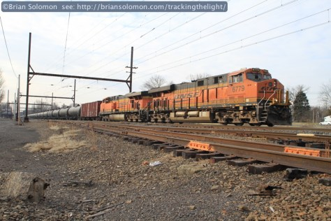 CSXT empty oil train K041 works northward behind the detoured stack train. BNSF locomotives make a bit of color in this otherwise drab New Jersey scene. Canon EOS 7D with 20mm lens.