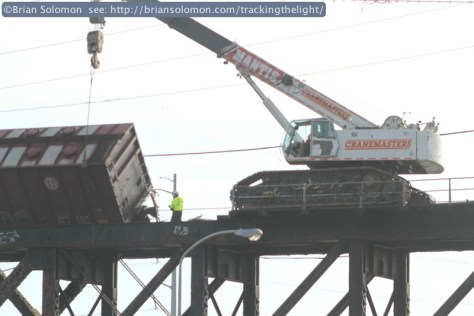 View from I-76; a crane attends to a derailed sand hopper at the site of the January 20, 2014 Schuylkill RIver Bridge derailment. Canon EOS  7D with 100mm lens.