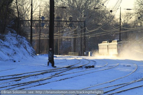 Canon 200mm view of a non-stop SEPTA MU east of Overbrook, PA, on January 23, 2014.