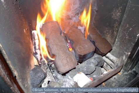 Bord na Mona peat briquettes make for an inviting domestic hearth.Exposed with a Lumix LX3 in February 2014.