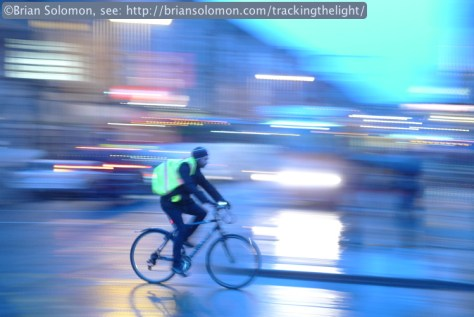 A cyclist negotiates O'Connell Street. Pan photo exposed at f2.8 1/6th of a second at ISO 200.