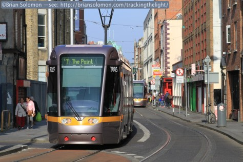 Inbound and outbound LUAS trams pass near the Jervis Stop.