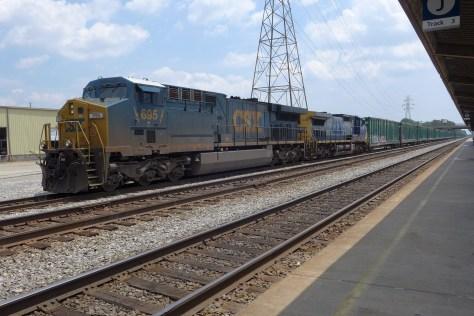 CSX AC6000CW leads an empty trash train bound for The Bronx at Staples Mills Station, Richmond, Virginia. Lumix LX-7 photo.