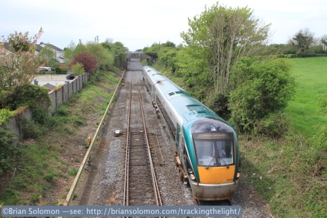 An ICR catches a burst of sun as it nears Kildare station. Exposed with a Canon EOS 7D with 20mm lens.