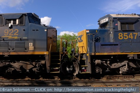 A modern GE Evolution-Series diesel faces a mid-1980s era SD50. The locomotives stopped, giving me ample time to make detailed views. LX-7 photo.