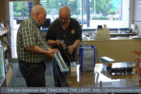 Bill Lanza (left) and Rich Reed (right) discuss locomotive details.