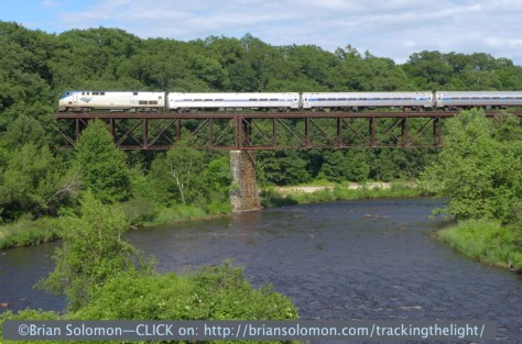Amtrak train 54 crosses the Millers Falls high bridge on June 21, 2014. This location presents several photographic challenges. The first is a deceptive angle. I made this view from the Route 63 bridge immediately to the west. While the two bridges are adjacent, they are not parallel, and the slight skewed crossing of the railroad bridge makes it difficult to make a level image. What appears level to the eye, isn't really level. Rather than gauge the bridge, it helps to watch the level of the Millers River. Of course, if you miss the level, you can always 'fix it in photoshop.'