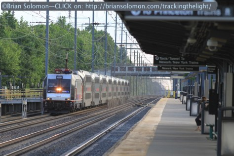 An eastbound New Jersey Transit train from Trenton glides toward Princeton Junction. Since track 1 is out of service, passenger will board from platform extensions to track 2. The fading light of this June evening made for an atmospheric image on the busy North East Corridor. Canon EOS 7D with 200mm lens.
