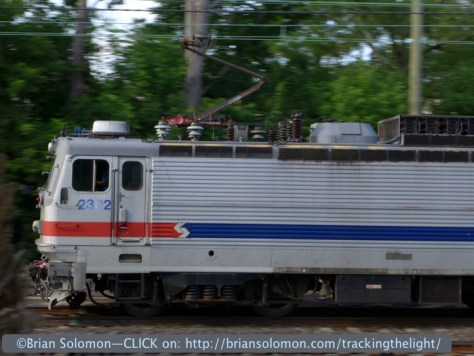 Panned view of SEPTA AEM-7 2302 westbound at Bryn Mawr on June 30, 2014. Lumix LX7 view.