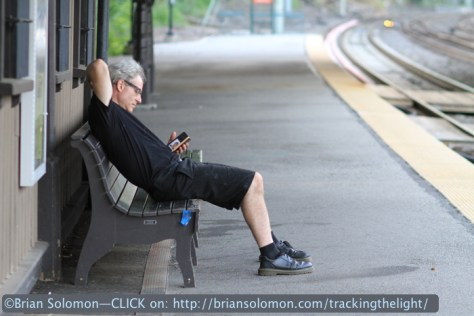 Sean Solomon checks the SEPTA app on his iPhone.