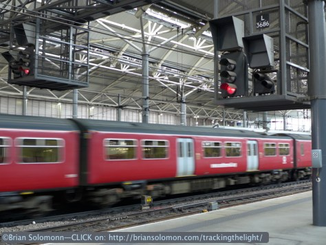 An electric multiple unit glides out of the station. Lumix LX7 photo.