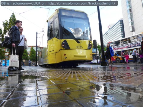 The Lumix LX7 allowed me to get some low angle views to accentuate the damp streets and reflect the clouds in the windows of the tram.