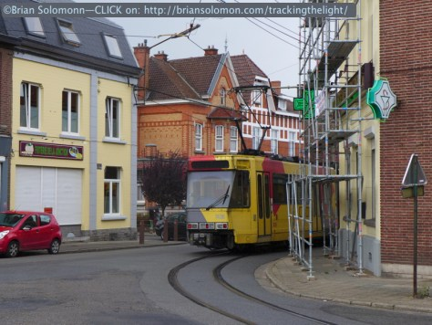 A tram takes a corner in Anderlues. Moments later  torrential rains dampened my photography. Lumix LX7 photo.