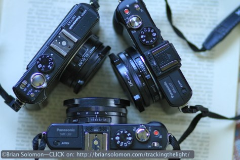Lumix cameras. My old LX3 is at top left. Top right and bottom are LX7s. Exposed with a Canon EOS 7D.