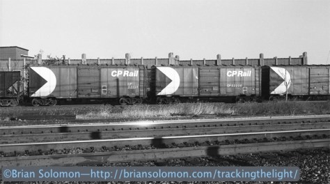 Canadian Pacific 40-ft boxcars roll through Rochester, New York in November 1986. Exposed on black & white film using a Canon A1 with 50mm lens.