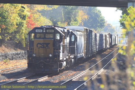 CSX's local freight was working the Palmer yard when I arrived. This pair of GP40-2s departed with 66 cars for West Springfield yard. Canon EOS 7D with 200mm lens. By carefully controlling flare, I was able to lighten the shadow areas in this backlit image.