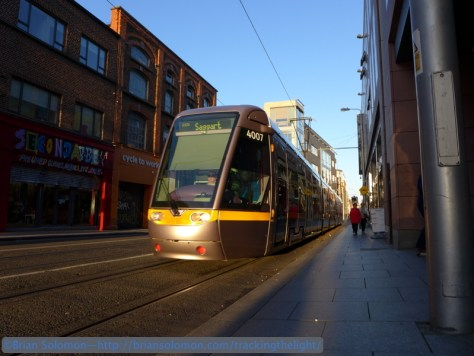 An outbound tram catches the sun on St. Mary's Abbey Street. I've used the same exposure technique described above to hold highlight detail on the front of the tram. Lumix LX7 photo.