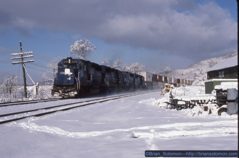 I found the old Chemung station. Not long after I got out of my car, I could hear the stack train roaring along; GP40-2s with nearly two miles of train. That old Canon A1 had a motor drive and I used it! Kodachrome 25 exposed with a Canon A1 and 50mm lens.